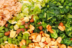 Variety of healthy vegetables. Variety of healthy green vegetables in an Asian vegetarian diet. Includes radish, onions, leafy vegetables, peanuts, and beans Royalty Free Stock Photo