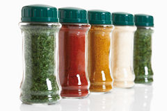 Variety of herbs and spices in glass jar on white background Stock Photography