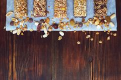 A variety of homemade granola bars, with nuts, raisins dried cherries and chocolate. Royalty Free Stock Image