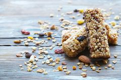 A variety of homemade granola bars, with nuts, raisins dried cherries and chocolate. Royalty Free Stock Photography