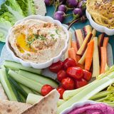 Variety of homemade hummus. With fresh vegetable sticks Stock Image