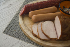 Variety of homemade smoked meat Royalty Free Stock Photos