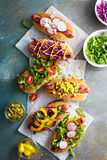 Variety of hot dogs with healthy garnishes Stock Photos