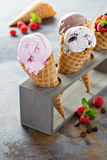 Variety of ice cream cones. Variety of ice cream scoops in cones with chocolate, vanilla and strawberry stock photography