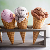 Variety of ice cream cones. Variety of ice cream scoops in cones with chocolate, vanilla and strawberry stock photos