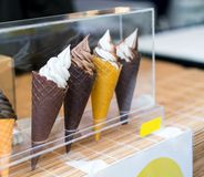 Variety of ice cream scoops in cones with chocolate, vanilla and Royalty Free Stock Photo