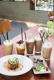 Variety iced coffee drinks on wooden table Royalty Free Stock Photo