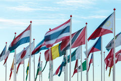 Variety of international flags. Against a blue sky in the afternoon Royalty Free Stock Photography