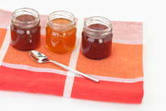 Variety of jam and spoon on napkin Stock Photo