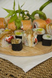 Variety of japanese maki on wooden plate Stock Photo