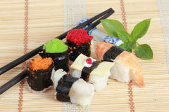 Variety Japanese Sushi with Chopstick on a bamboo mat Royalty Free Stock Image
