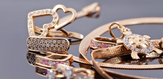 A variety of jewelry on the reflecting surface Stock Photo