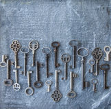 Variety of keys on dark background Royalty Free Stock Images