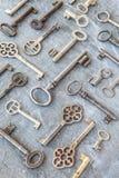 Variety of keys on dark background Royalty Free Stock Photo