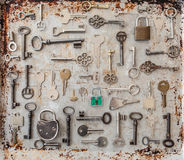 Variety of keys on rusty background Stock Images