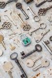 Variety of keys on rusty background Stock Photos