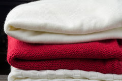 Variety of knitted winter sweaters Royalty Free Stock Photo