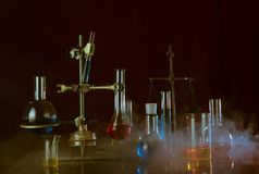 Variety of laboratory vessels with a colored reagents in a rack. A chemical reaction. Variety of laboratory vessels with a colored reagents in a rack. Chemical royalty free stock photo