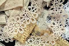 The variety of lace on the black  background Stock Photography
