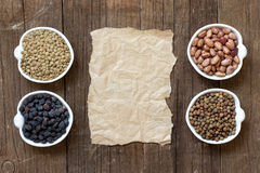 Variety or legumes and paper Stock Photos