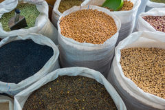 Variety of legumes in white bags Stock Photos