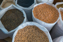 Variety of legumes in white bags Royalty Free Stock Photo