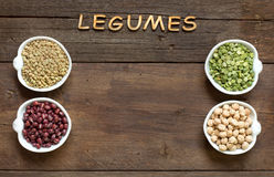 Variety or legumes and the word of Legumes on wood Royalty Free Stock Photos