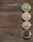 Variety or legumes and the word of Legumes on wood Royalty Free Stock Photo