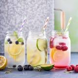 Variety of lemonade in jars Royalty Free Stock Photos