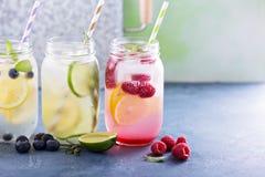 Variety of lemonade in jars Stock Image