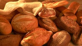 Variety of loaves of bread. Harvest of the farm. Healthy eating and traditional bakery concept stock footage