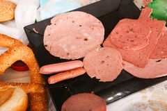 Luncheon meat close up. Variety of luncheon meat on dish with white background Stock Images