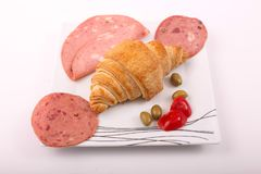 Luncheon meat with croissant. Variety of luncheon meat on dish with white background Stock Photos