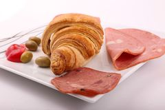 Luncheon meat with croissant. Variety of luncheon meat on dish with white background Royalty Free Stock Photos
