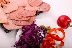 Luncheon meat with salad close up. Variety of luncheon meat on dish with white background Stock Images