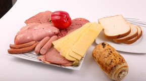 Luncheon meat with Turkish cheese. Variety of luncheon meat on dish with white background Stock Image