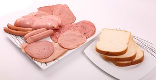 Variety of luncheon meat with bread. Variety of luncheon meat on dish with white background Royalty Free Stock Images