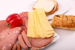 Luncheon meat with bakery. Variety of luncheon meat on modern dish over white background Royalty Free Stock Photos