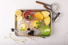Variety of margarita cocktails on a tray. Variety of margarita cocktails with bartender tools on a tray overhead shot stock photography
