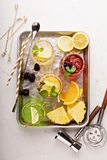 Variety of margarita cocktails on a tray. Variety of margarita cocktails with bartender tools on a tray overhead shot Stock Images