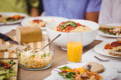Variety of meals on dining table Royalty Free Stock Images