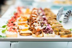 Variety of meat and fish canapes Stock Images