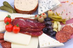 Variety of meat products and cheese royalty free stock photos