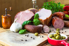 Variety meat products wooden cutting boards Royalty Free Stock Photo