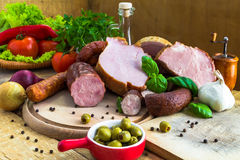 Variety meat products wooden cutting boards Stock Images