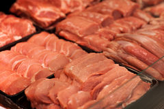Variety of meat slices in boxes in supermarket Royalty Free Stock Images