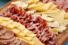 Variety of meats. And cheeses olives delicacies Royalty Free Stock Photo