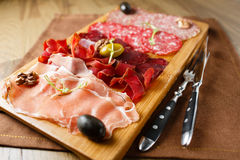 Variety of meats, sausages, salami, ham, olives Stock Photo