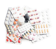 Variety of medications isolated background. Variety of medications tablets and pills background isolated on white Royalty Free Stock Photo