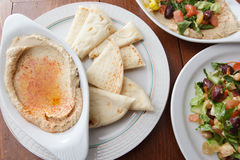 Variety of Mediteranean style dishes like hummus and salad Stock Photography